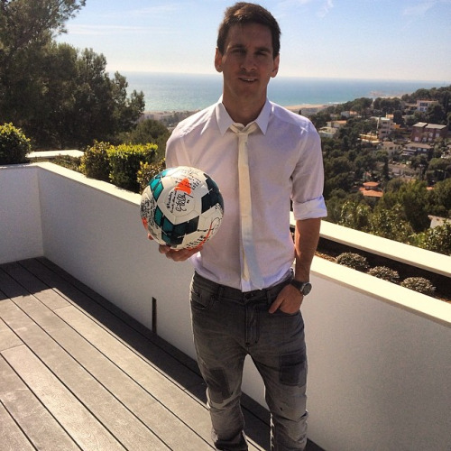 Messi on his Barcelona balcony