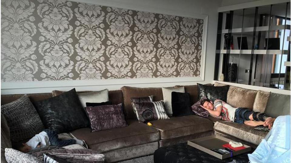 Lionel Messi relaxes on couch in home