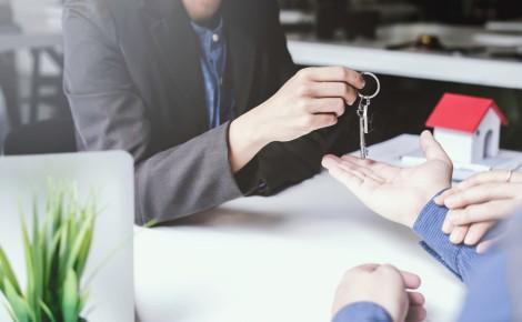real estate agent handing keys - Cindy Shearing used Feb2020